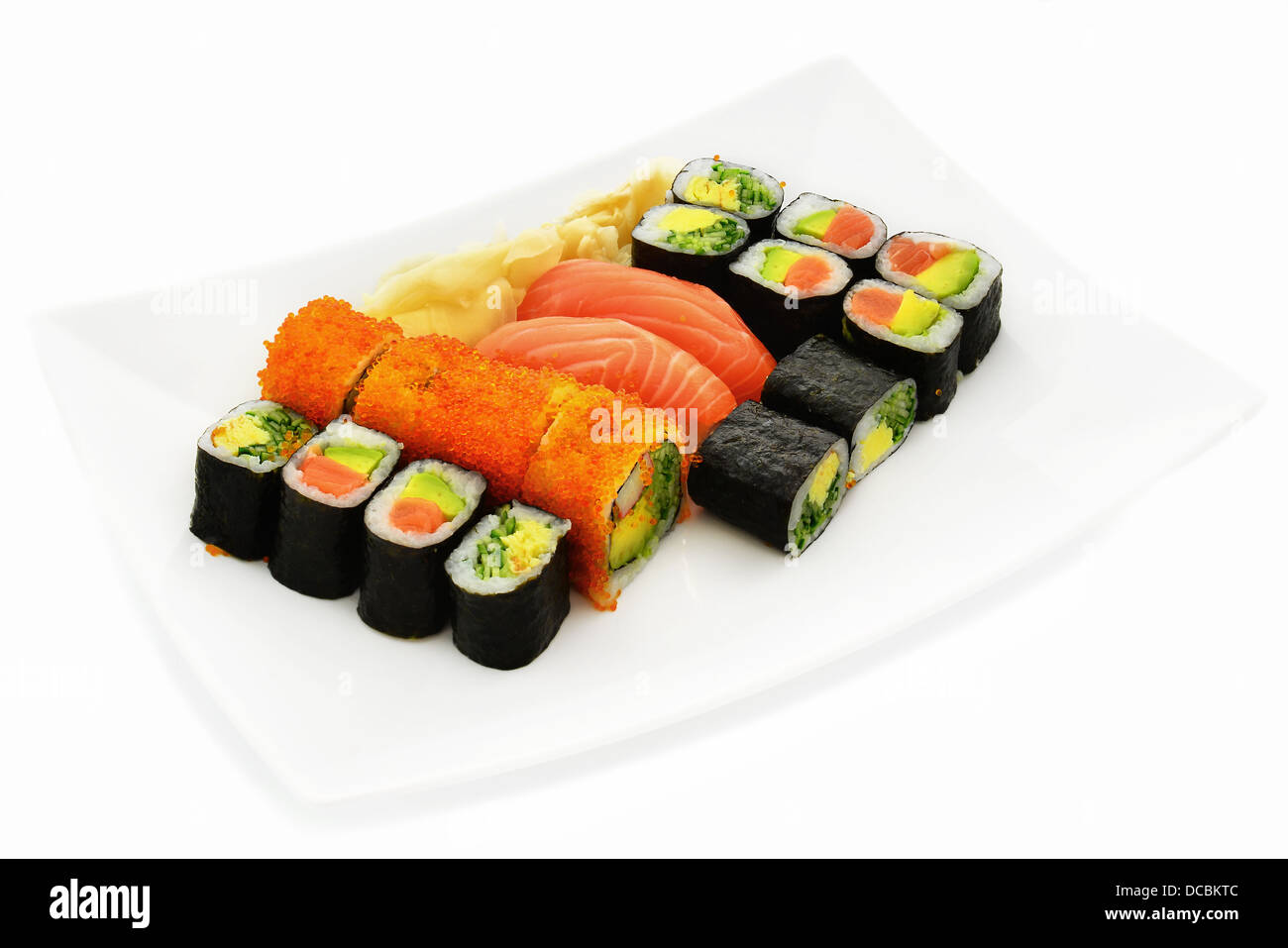 Sushi with fish, caviar, avocado, egg and cucumber. - Stock Image