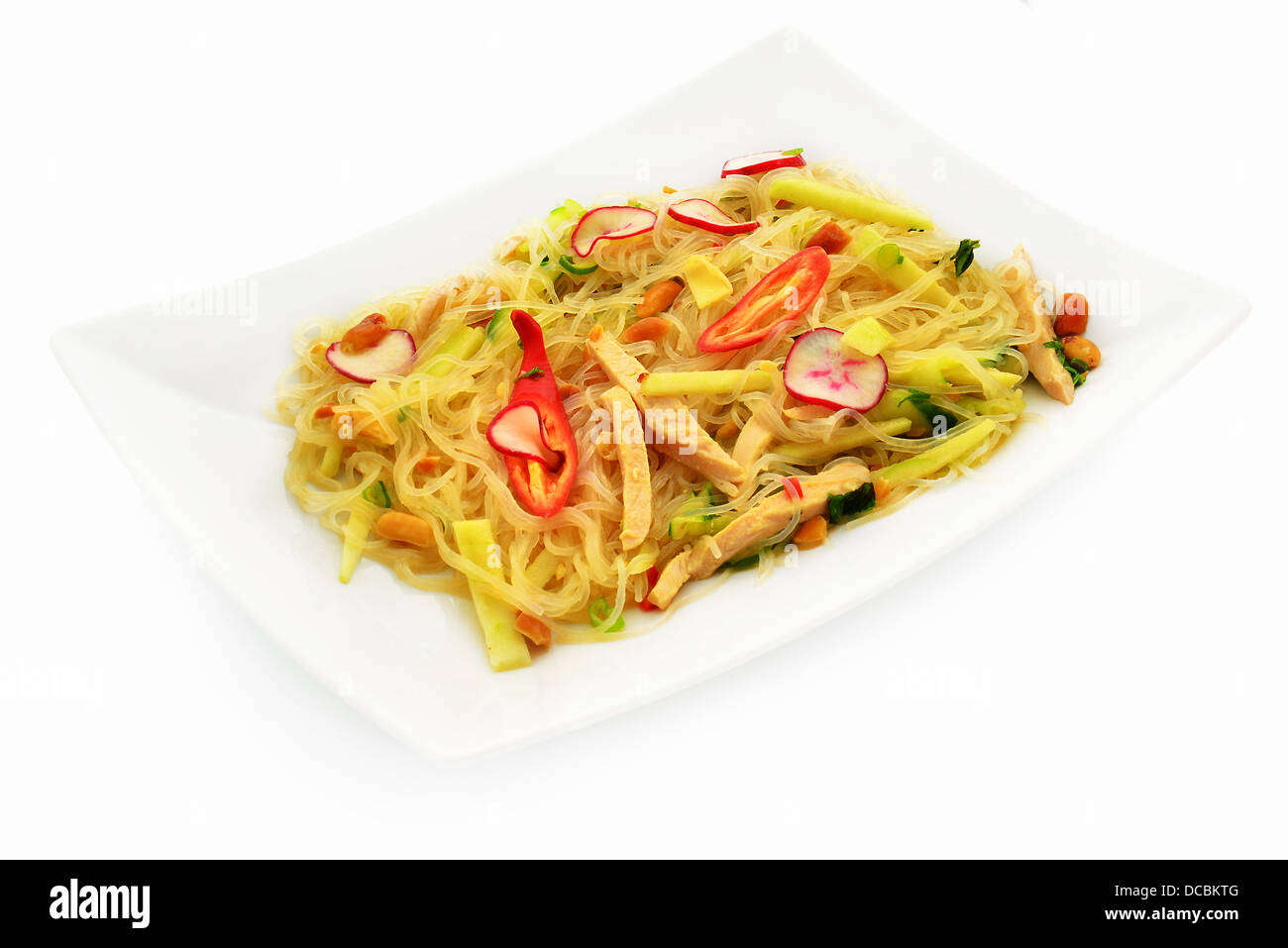 Vietnamese salad with noodles, chicken, nuts, hot pepper, apple and radish, - Stock Image