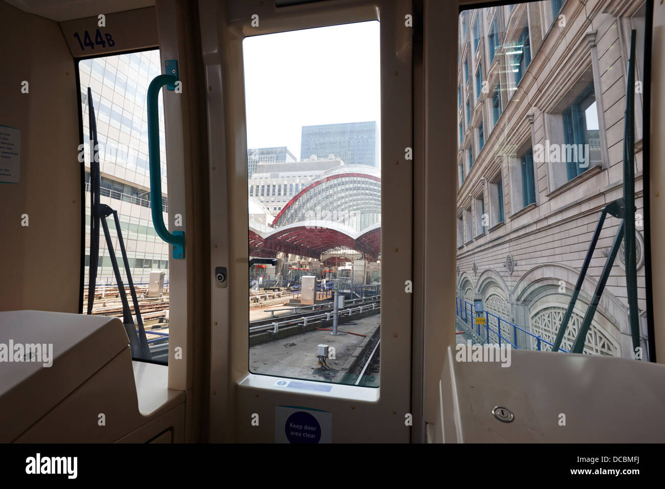 inside carriage at docklands light railway dlr canary wharf station London England UK - Stock Image