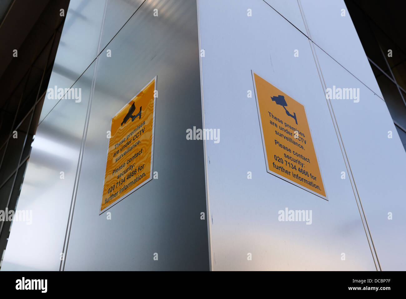 premises under cctv surveillance signs in canary wharf London England UK Stock Photo