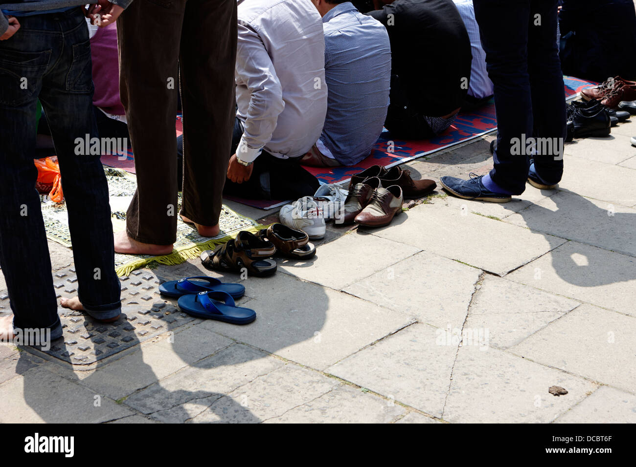 british muslims answer midday call to prayer at mosque in central London England UK - Stock Image