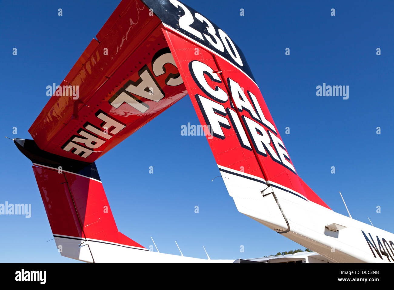 Tail of a Cal Fire OV-10 Bronco contrasts the California sky. T - Stock Image