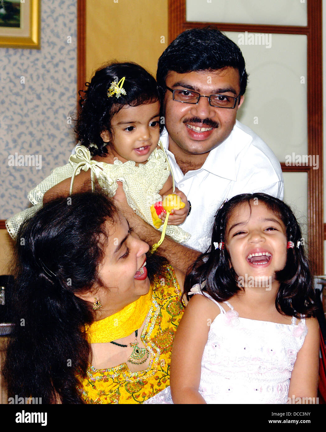 24685196b Happy Indian family Singapore People Parents Kids Cheerful Portrait ...