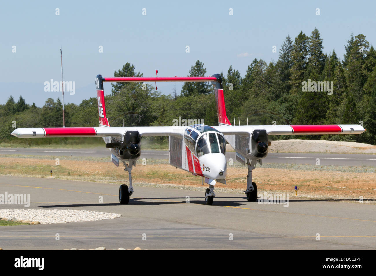 Cal Fire OV-10 Bronco taxis at the Nevada County Air Attack Base prior to a firefighting mission. - Stock Image