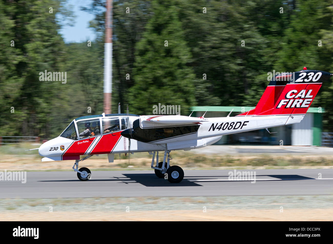 Cal Fire OV-10 Bronco on take off roll at the Nevada County Air Attack Base at the start of a firefighting mission. - Stock Image