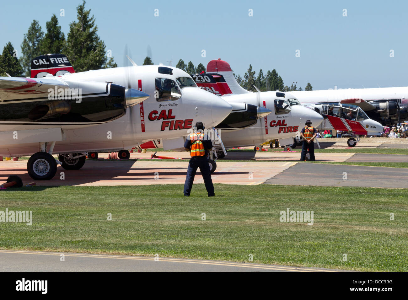 A pair of Cal Fire Turbo Trackers and an OV-10 Bronco prepare to launch at Nevada County Air Attack Base. - Stock Image