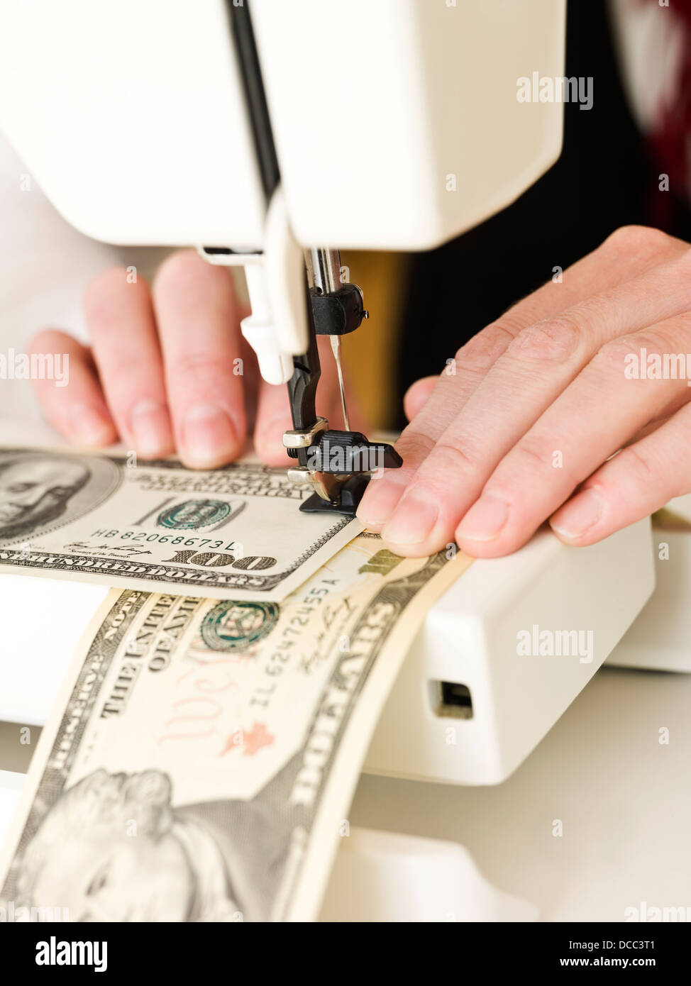 Sewing a dollar bank note - Stock Image