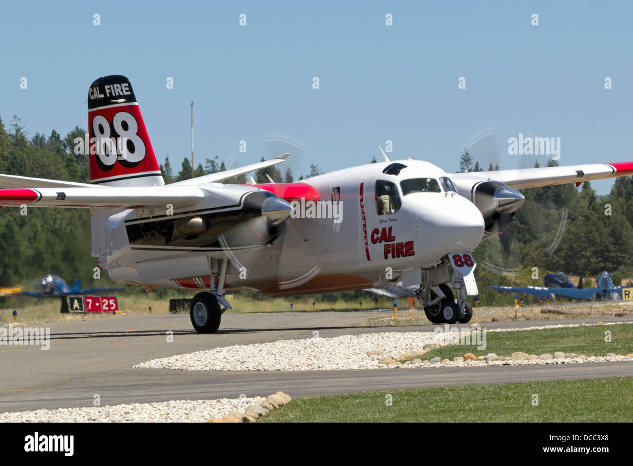 Calfire Grumman S2-T Turbo Tracker taxis at the Grass Valley Air Attack Base. - Stock Image