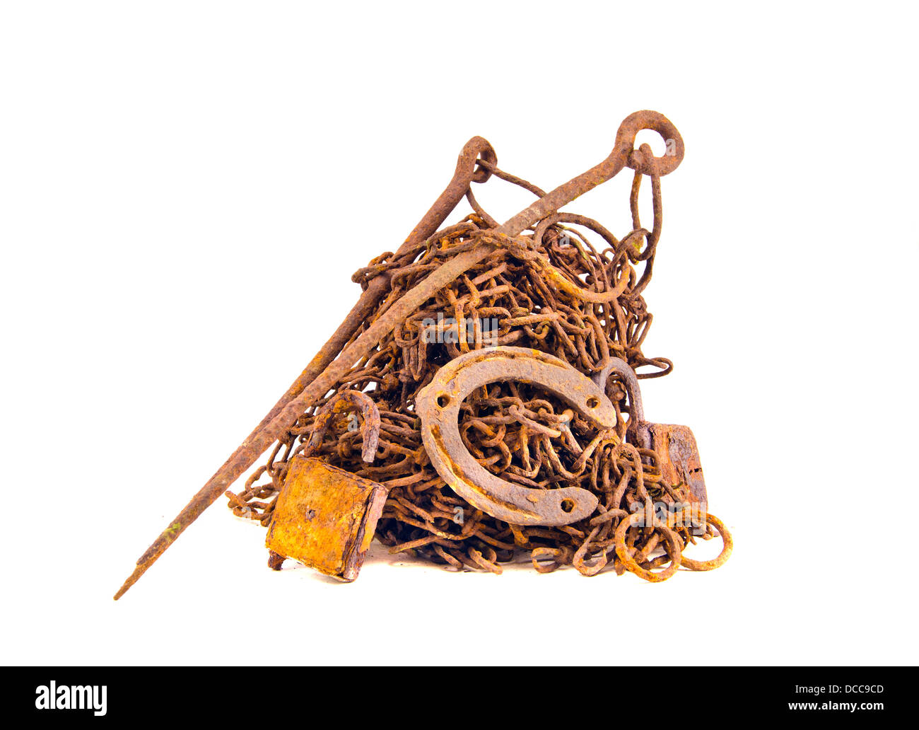 rusty and aged metal iron scrap for recycling  isolated on white - Stock Image