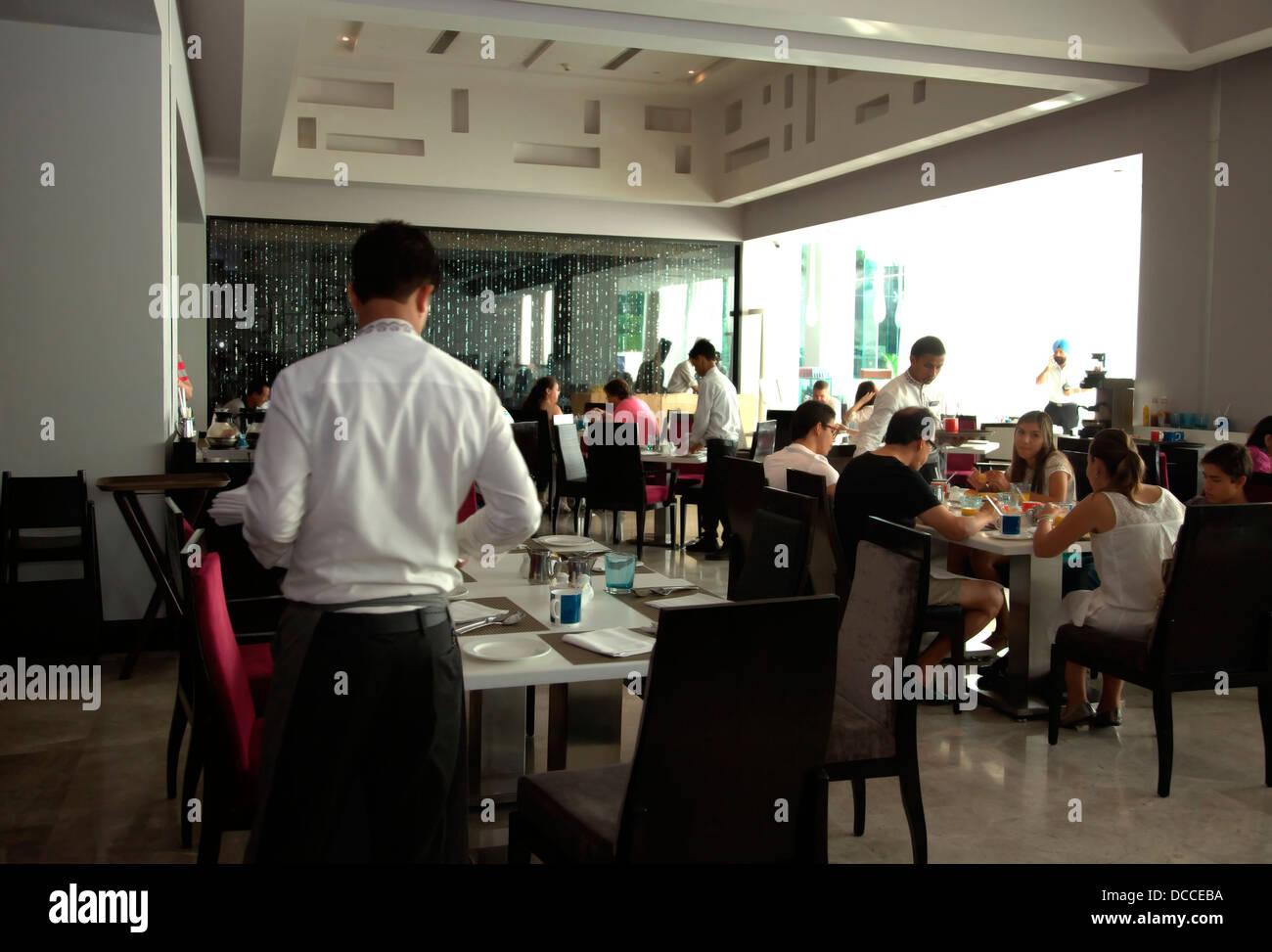 Restaurant,People,Dining,Hotel Radisson Blu,Agra,India,coffee shop,food,eating - Stock Image