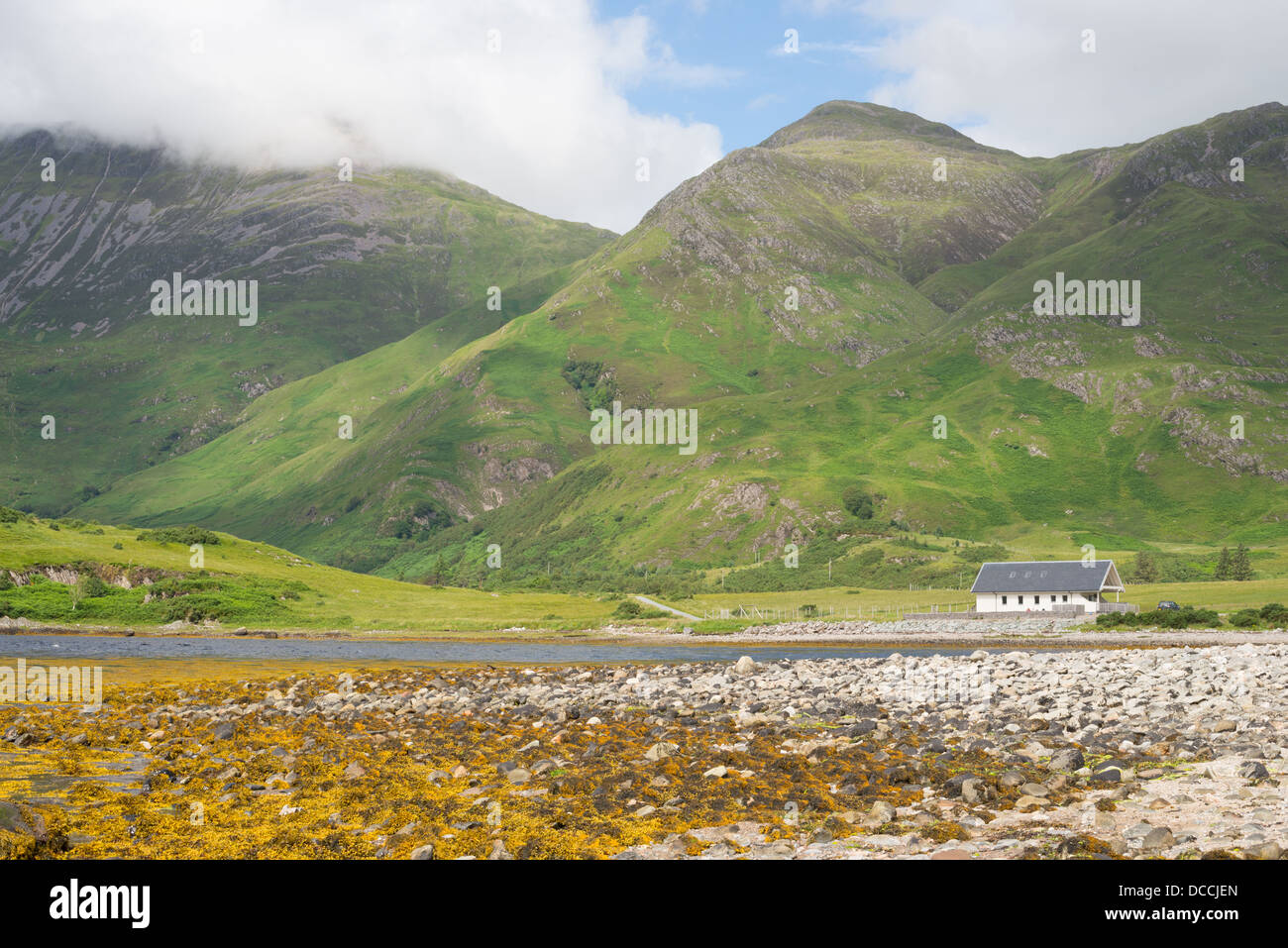 A cottage in Corran, at the base of Beinn Bhuidhe in the Scottish Highlands - Stock Image