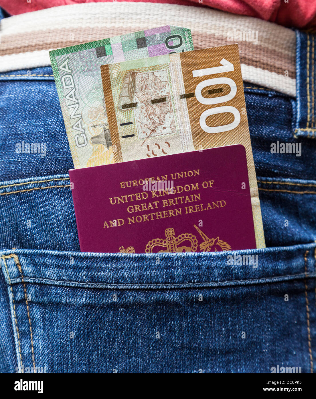 Passport and Canadian dollars - Stock Image
