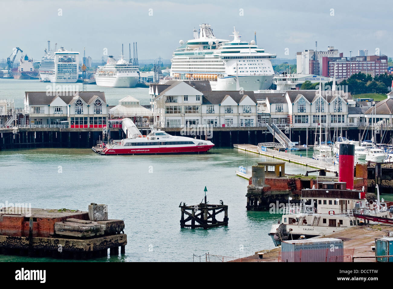 Cruise ships, fast Isle of Wight ferry, and the preserved historic tug tender Calshot (foreground) in the port of - Stock Image