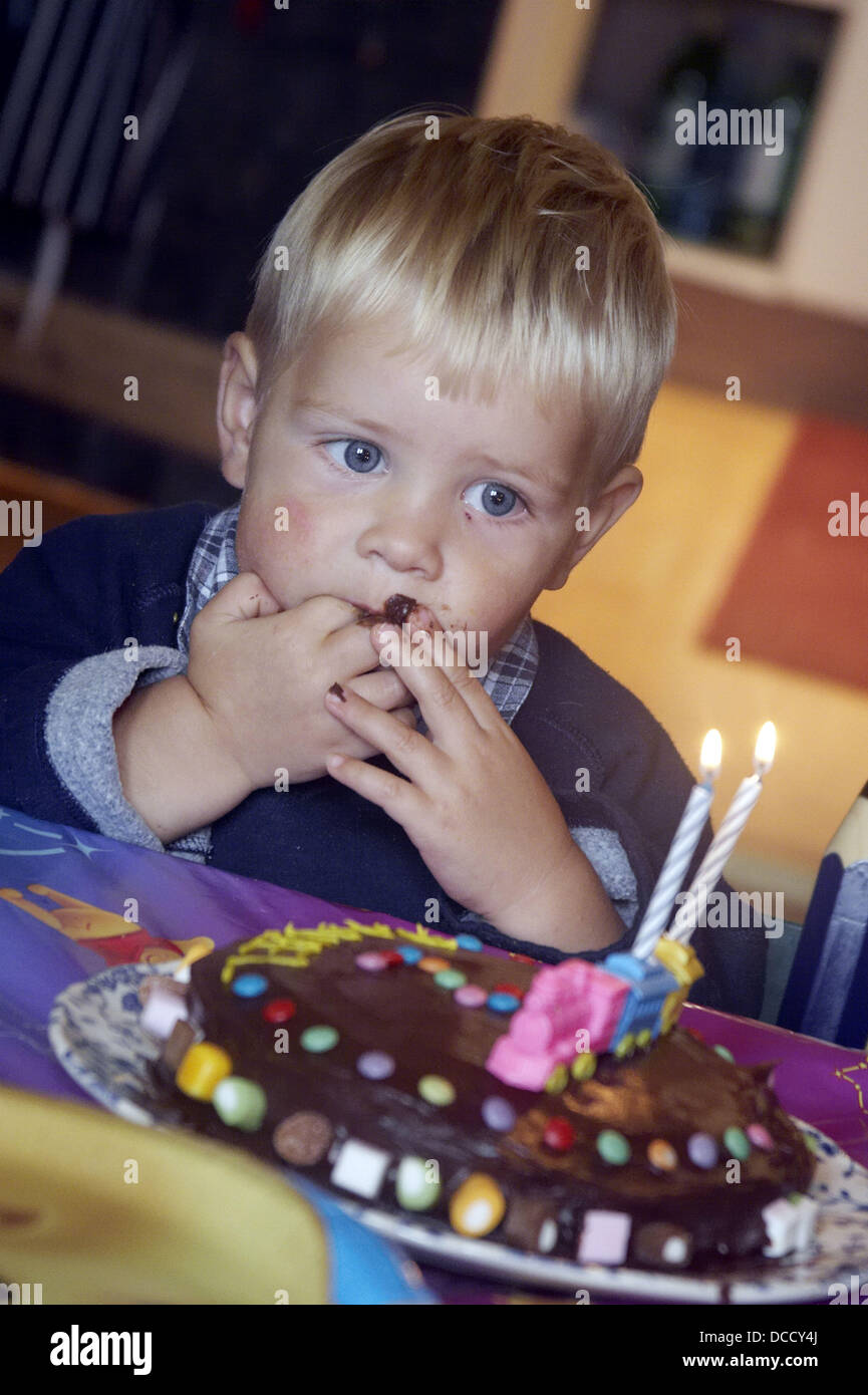 2 Year Old Boy Looking At His Birthday Cake With Chocolate Round Mouth Eating
