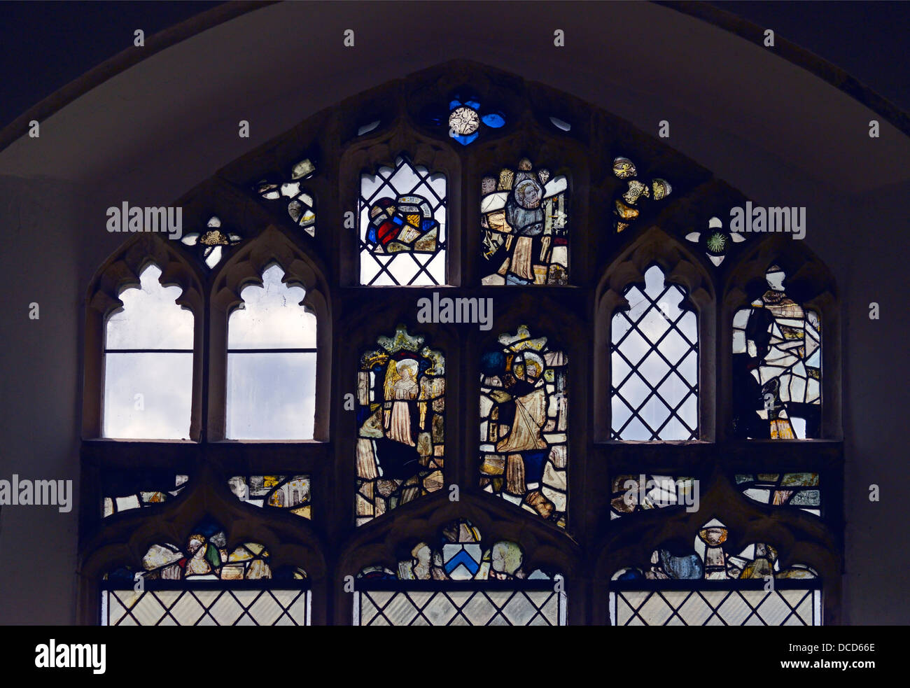 Medieval stained glass fragments. Church of the Holy Trinty. Blythburgh, Suffolk, England, United Kingdom, Europe. - Stock Image