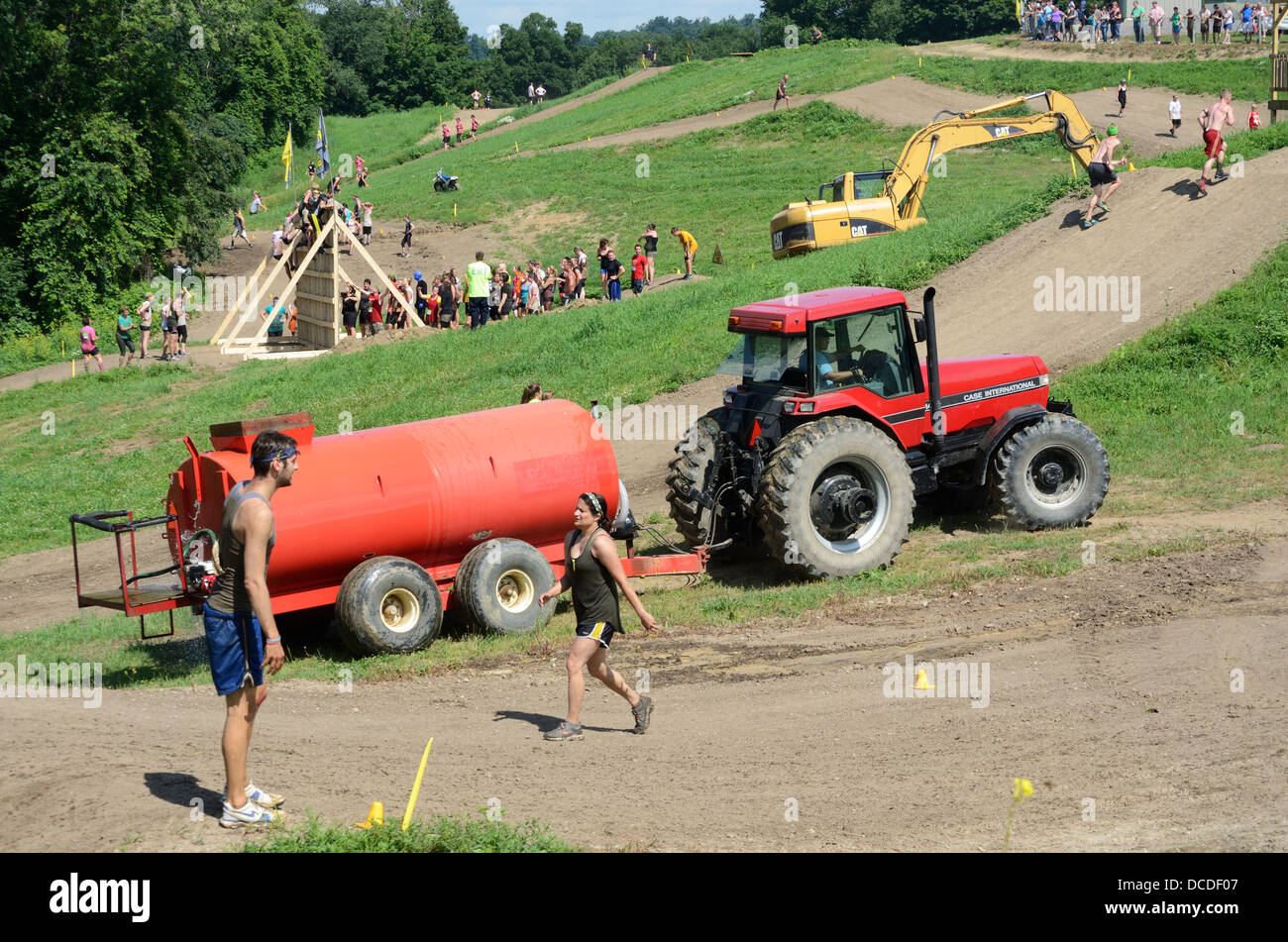 Obstacle course in 'The 5k Mud Factor' in Pavilion NY. - Stock Image