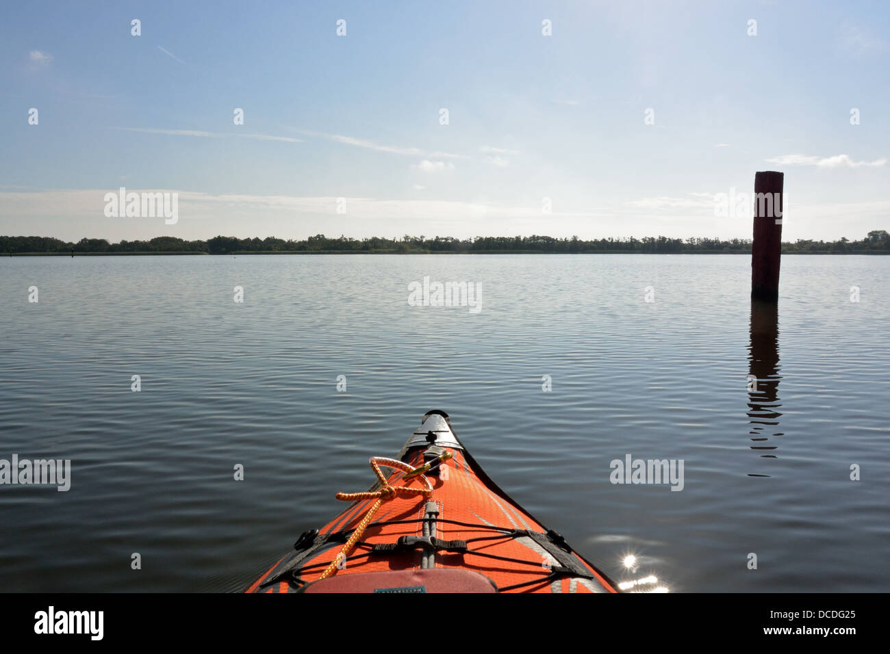 Channel marker post seen in the placid waters of Barton Broad, Norfolk, from an Advanced Elements AdvancedFrame Stock Photo