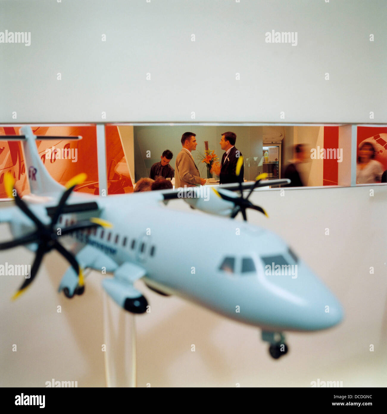 Business deals being sealed at the ATR aviation stand during the bi-annual aerospace industry expo at the Farnborough - Stock Image