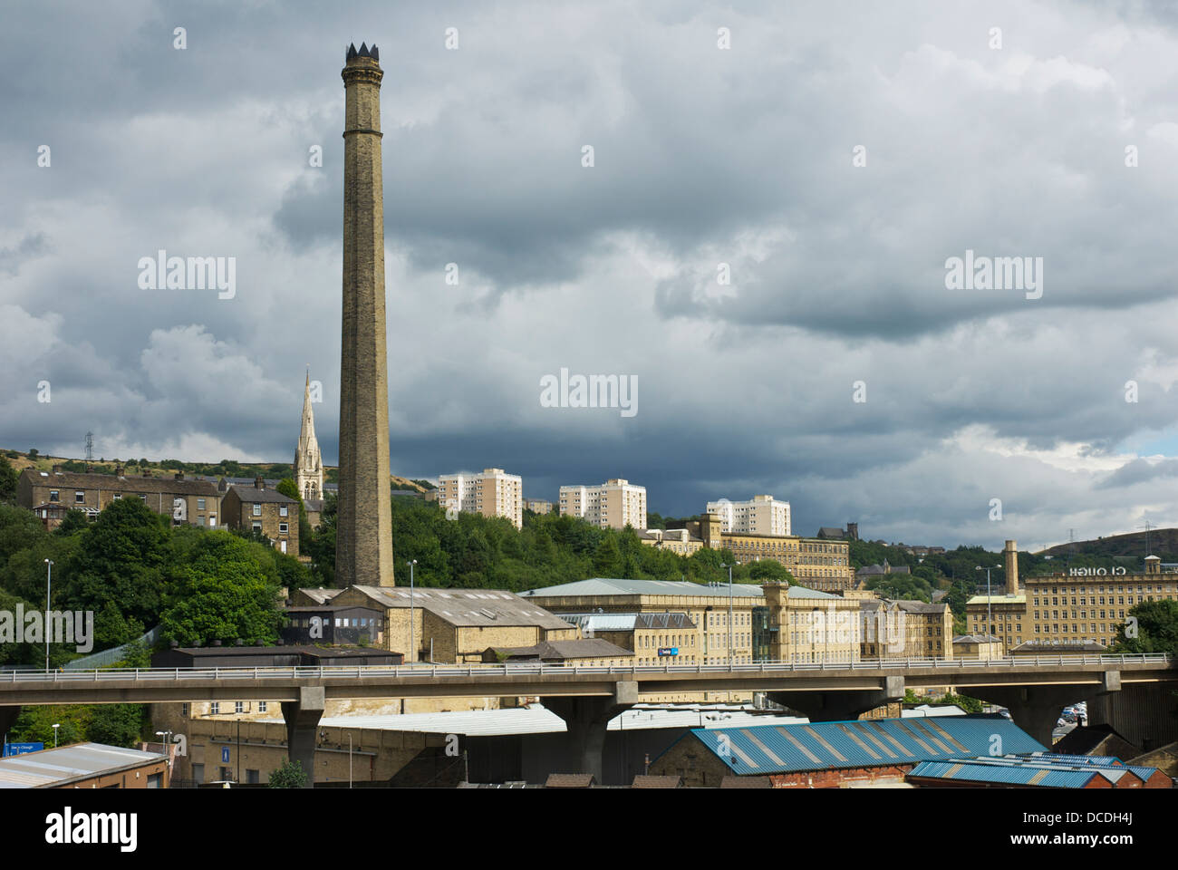 The skyline of Halifax, West Yorkshire, England, UK, with mill chimney and Burdock Way flyover - Stock Image
