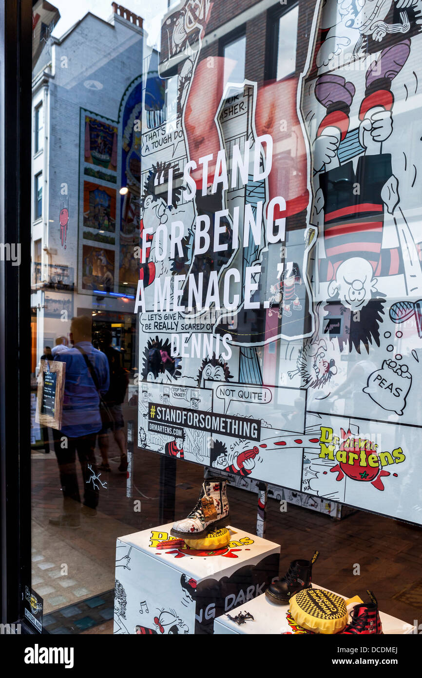 Boots and  Dennis the Menace cartoons in window of Doctor Martens shoe store in Carnaby street, London, W1 Stock Photo