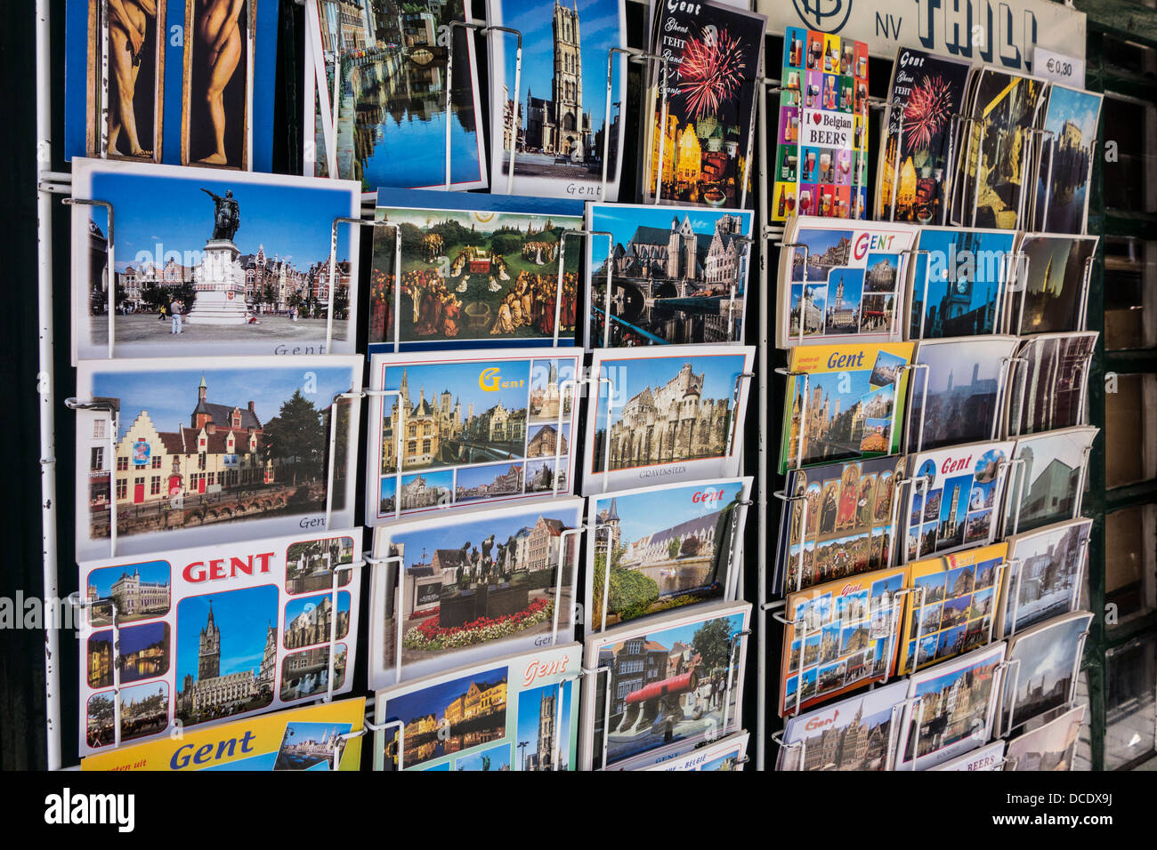 Tourist postcards from the historic city center of Ghent on display in rack of souvenir shop, East Flanders, Belgium - Stock Image