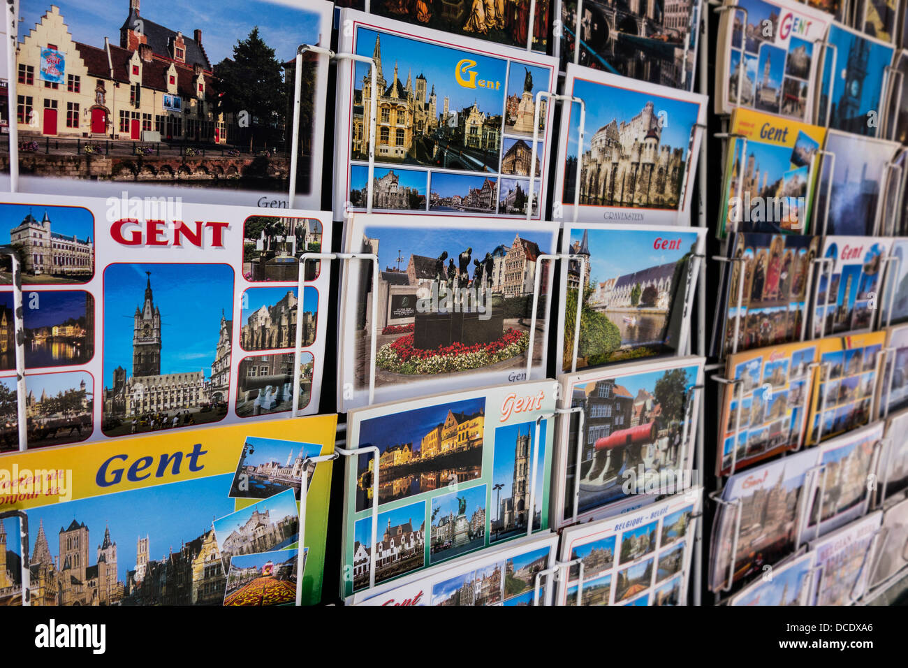 Tourist postcards from the historic city center of Ghent on display in rack of souvenir shop, East Flanders, Belgium Stock Photo