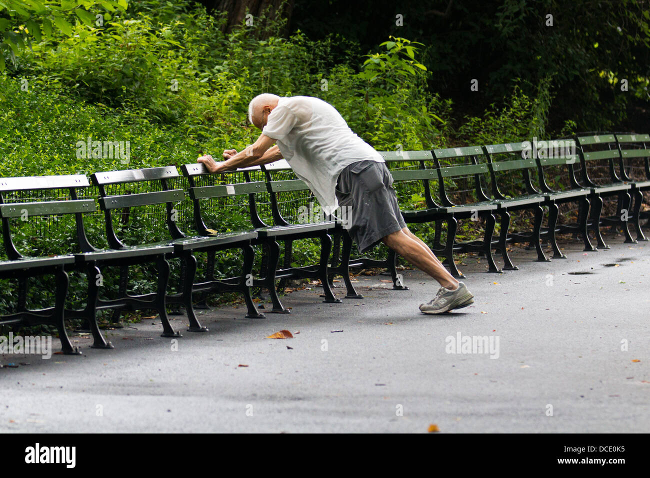 Senior Man stretching in Central Park Stock Photo