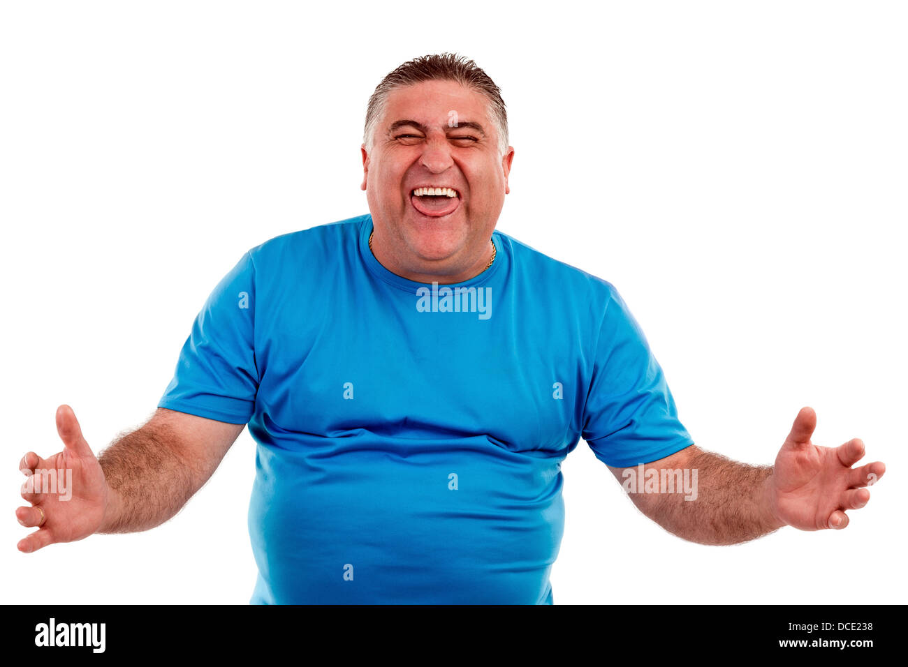 A man laughing hysterically at something hilarious with a funny expression on his face. - Stock Image