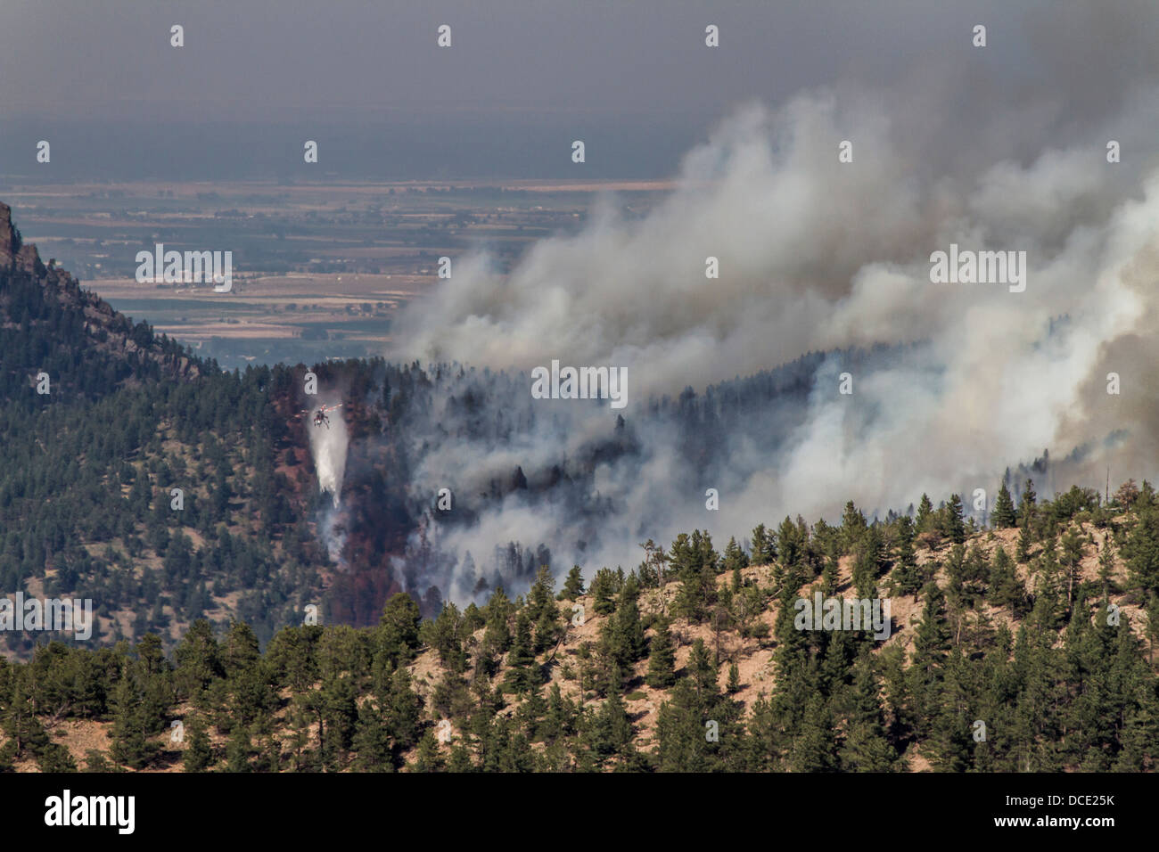 USA, Colorado, Boulder, Flagstaff Fire, Helicopter Dropping Water on