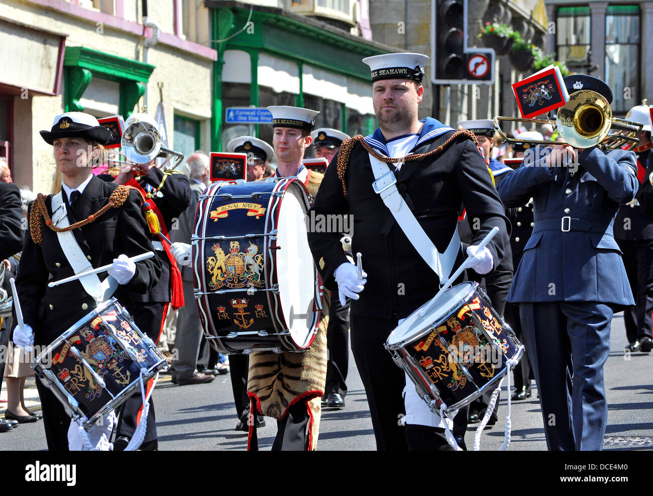 The Royal Navy Band marching through the streets of Helston in Cornwall, UK - Stock Image