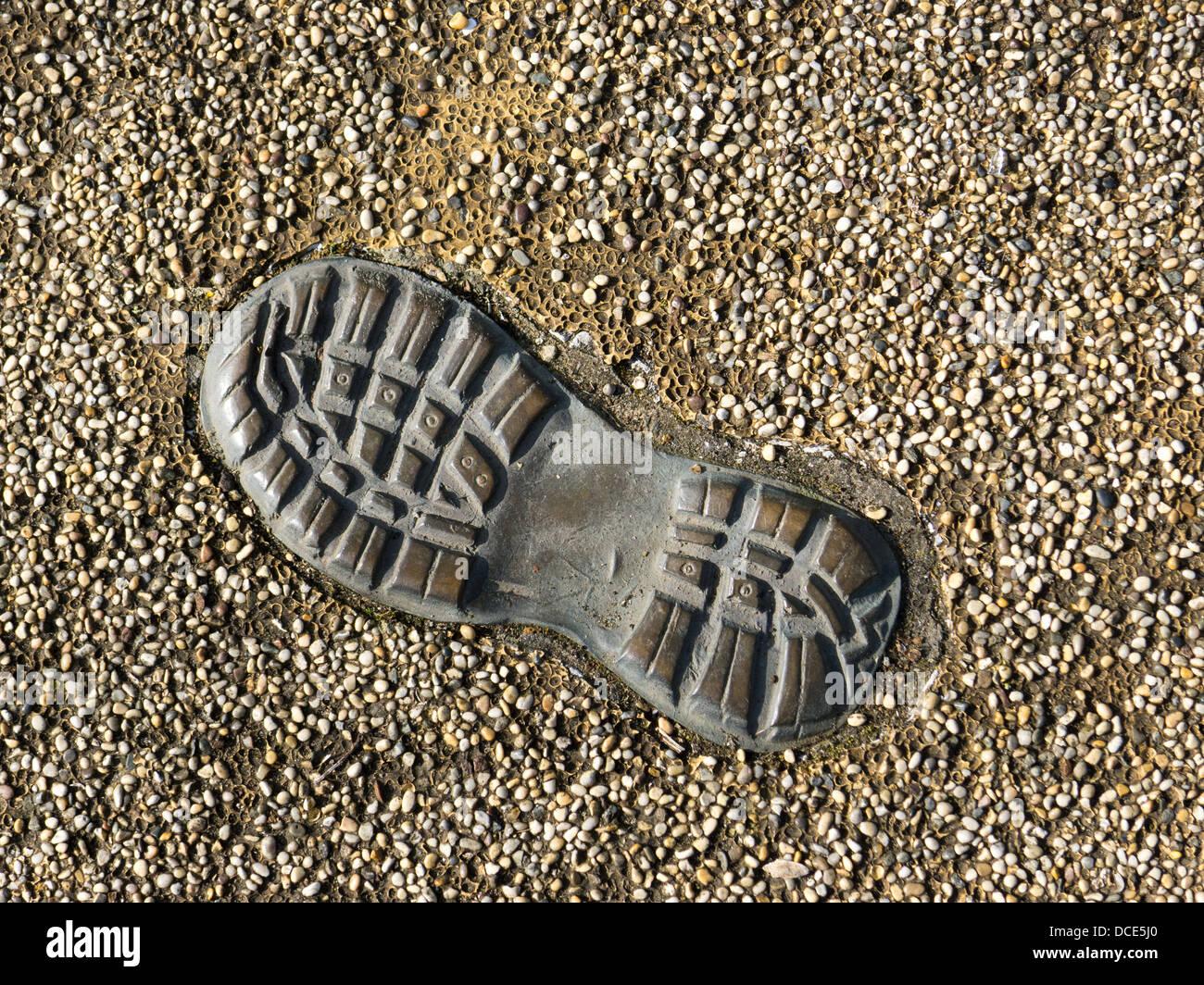 Footprint sculpture - Stock Image