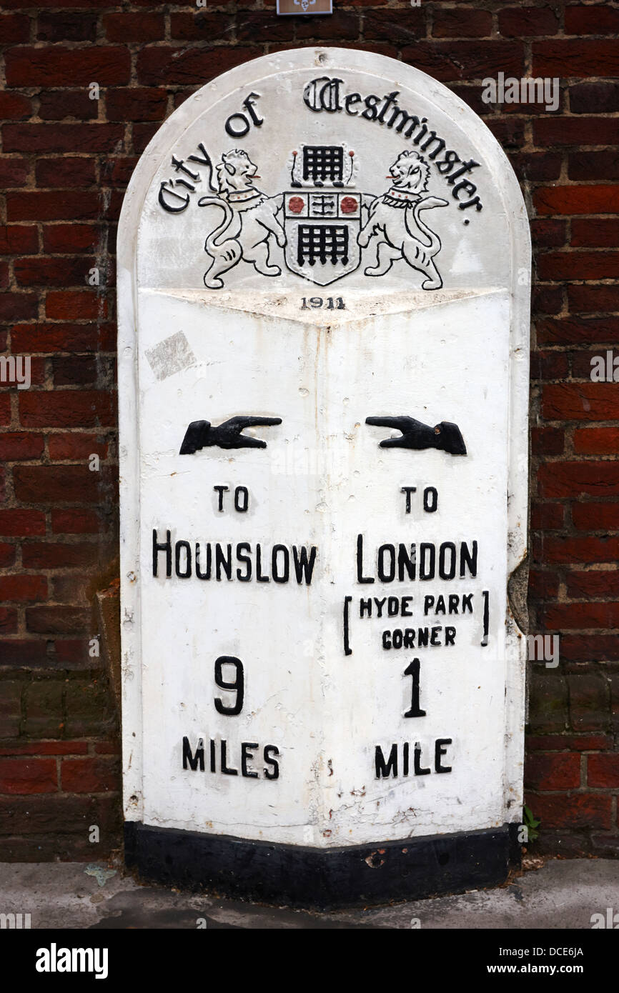 city of westminster old metal milestone between london and hounslow London England UK - Stock Image