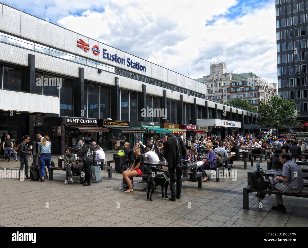 Concrete concourse and shops at Euston Station London - Stock Image