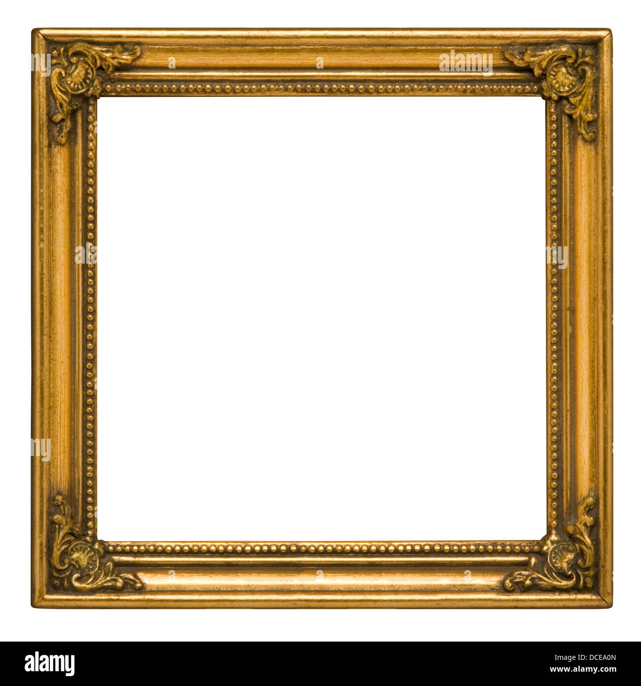 Antique square picture frame painted gold against white background - Stock Image