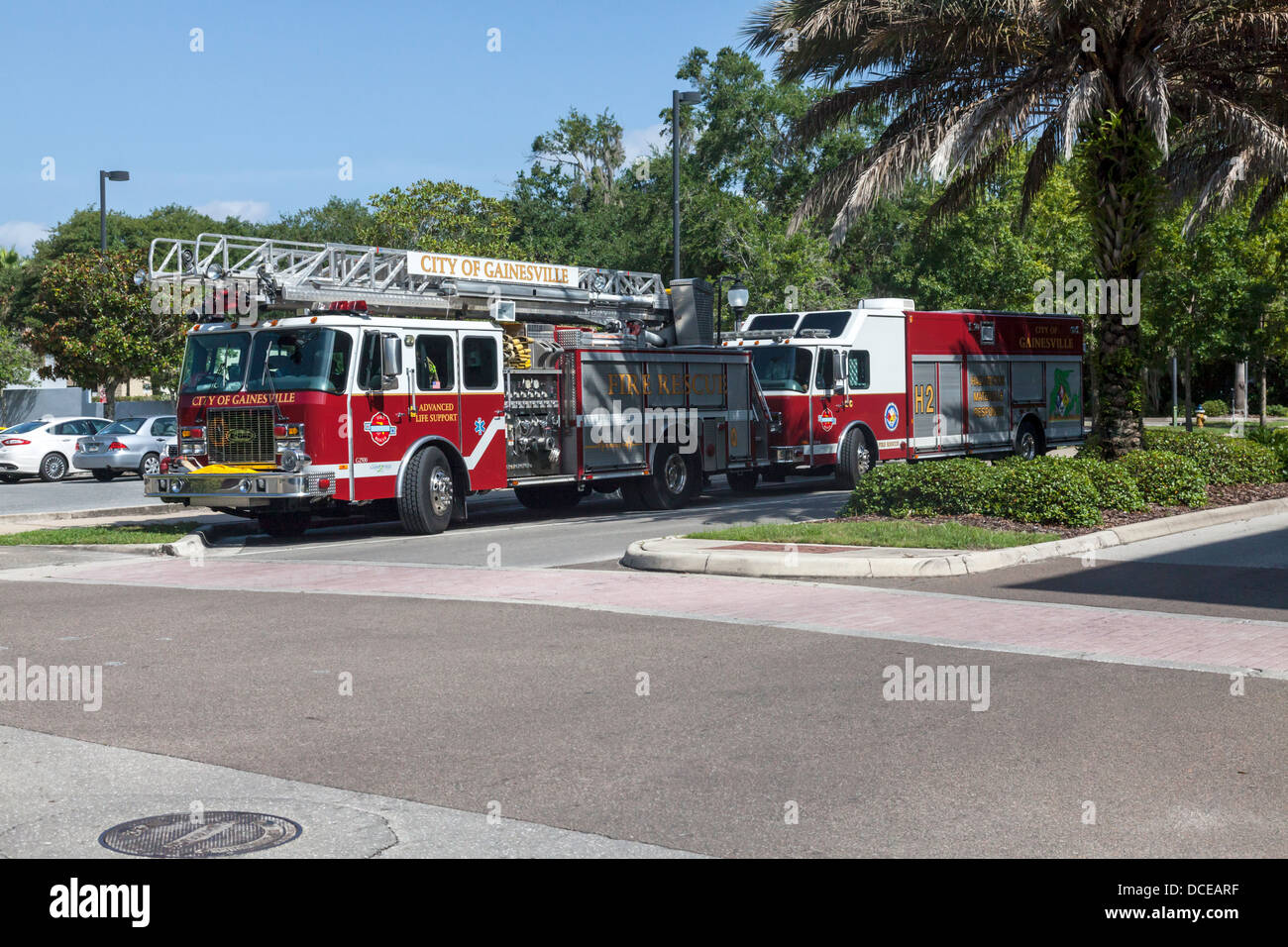 Fire ladder truck and Hazmat vehicle parked. - Stock Image