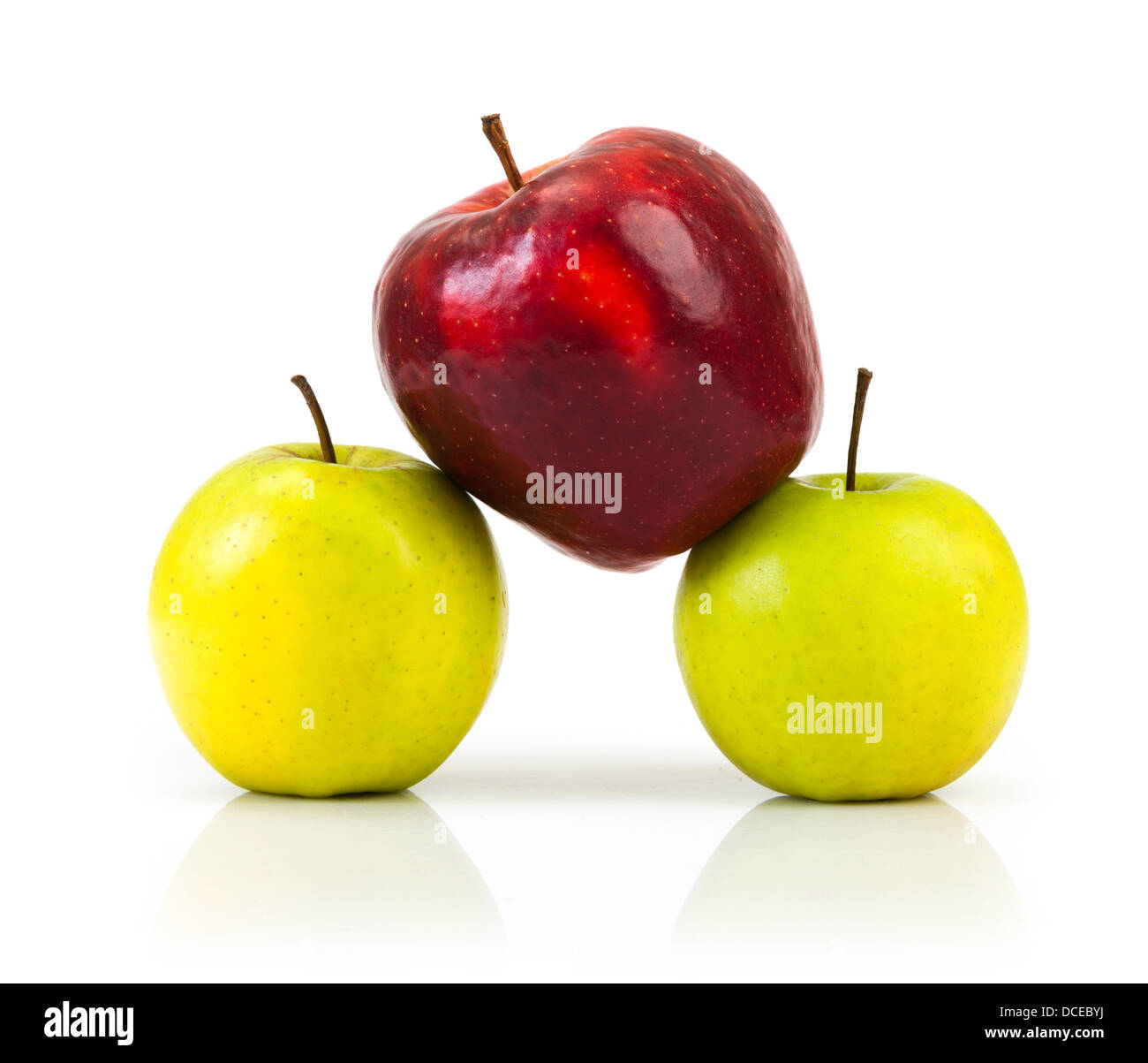 domination concepts - red apple between green apples - Stock Image