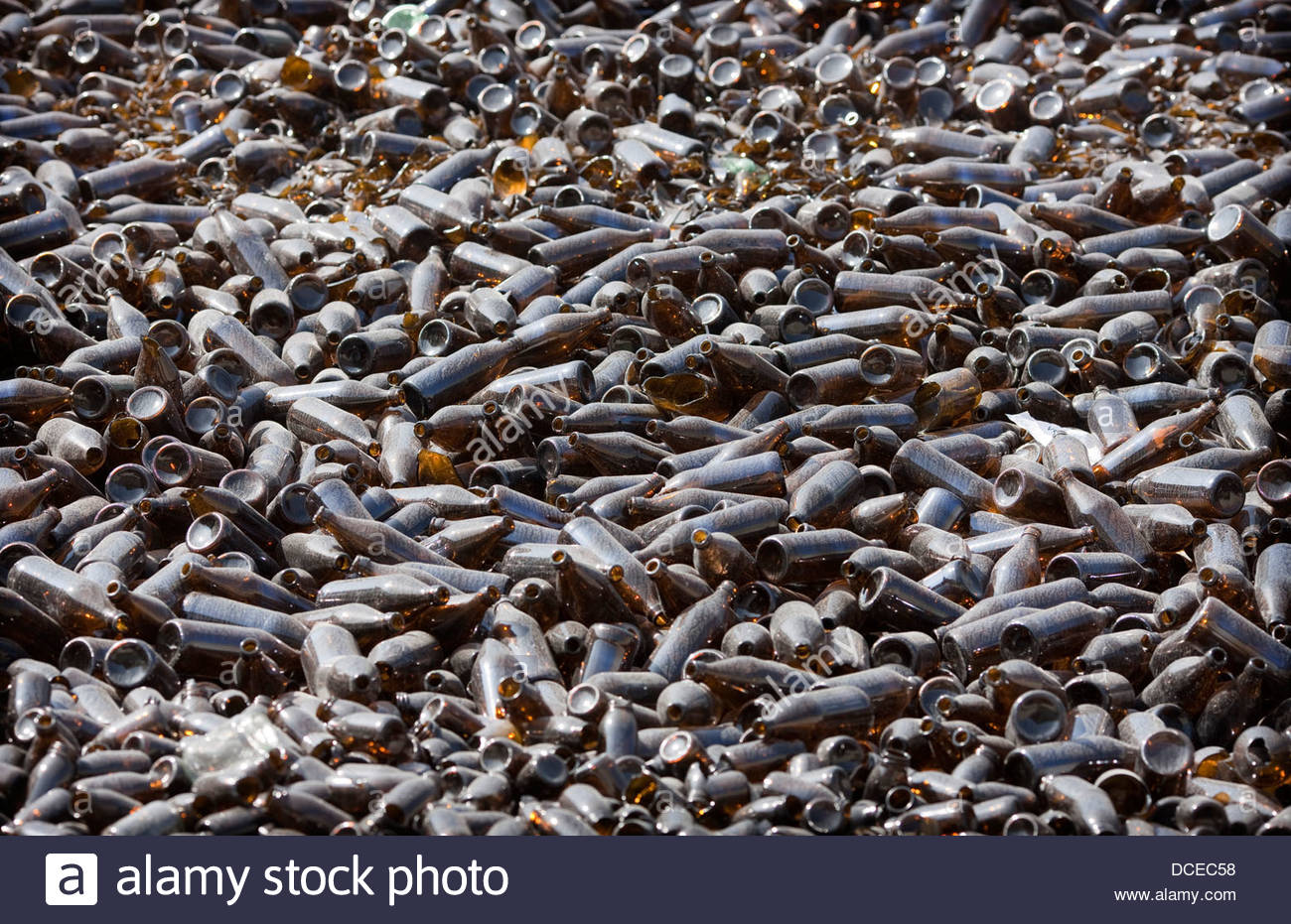 Beer bottles at a scrap yard, Neuburg, Bavaria, Germany - Stock Image