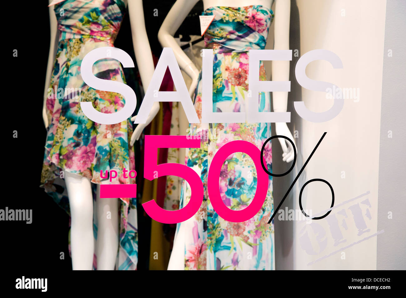 Fashion clothing on sale in shop - Stock Image