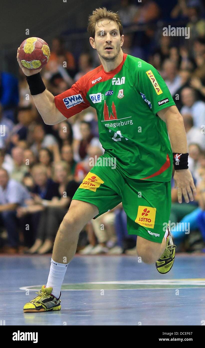 Magdeburg's Michael Haass has the ball during the handball test match between SCMagdeburg and Wisla Plock - Stock Image
