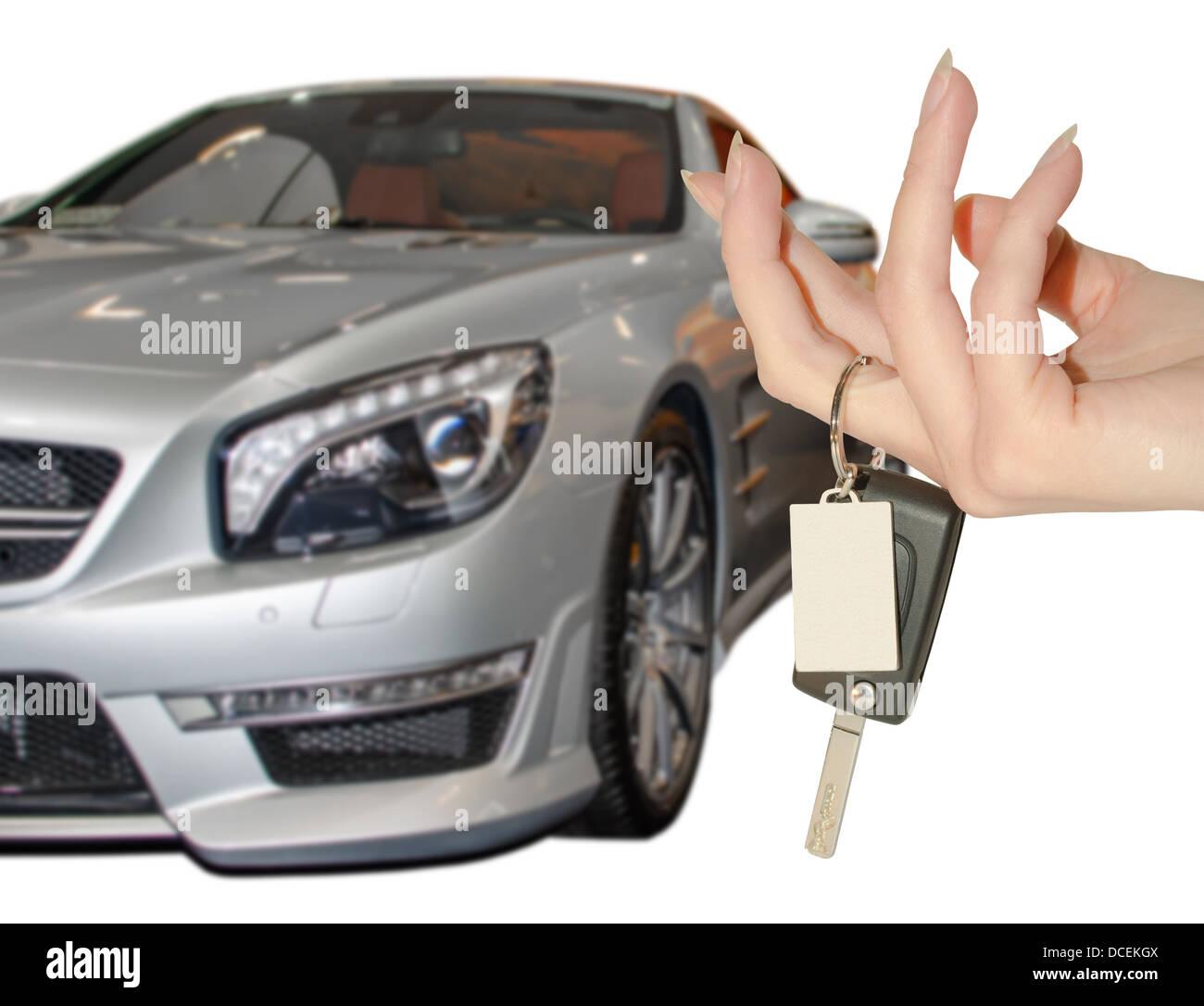 Elegant Female Hand Holding Car Keys Against Expensive Premium Class