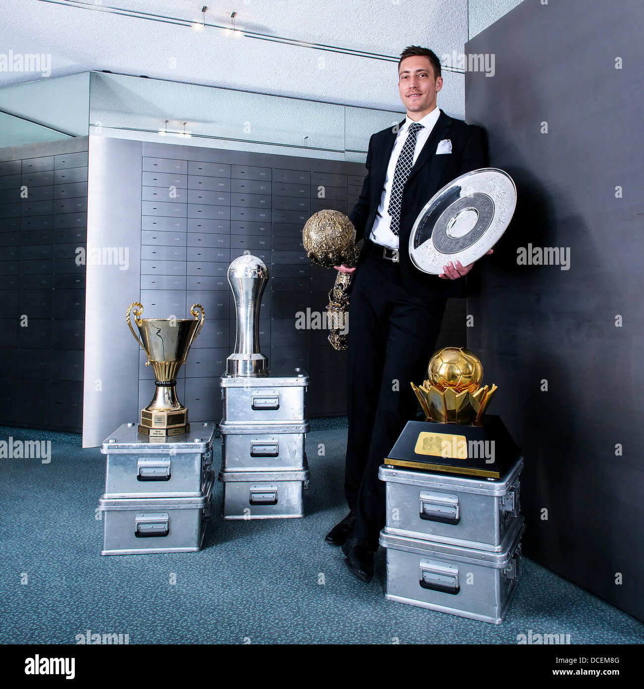 Sweden's Marcus Ahlm poses with his trophies that he has won over his ten year carreer (2003-2013) with the - Stock Image