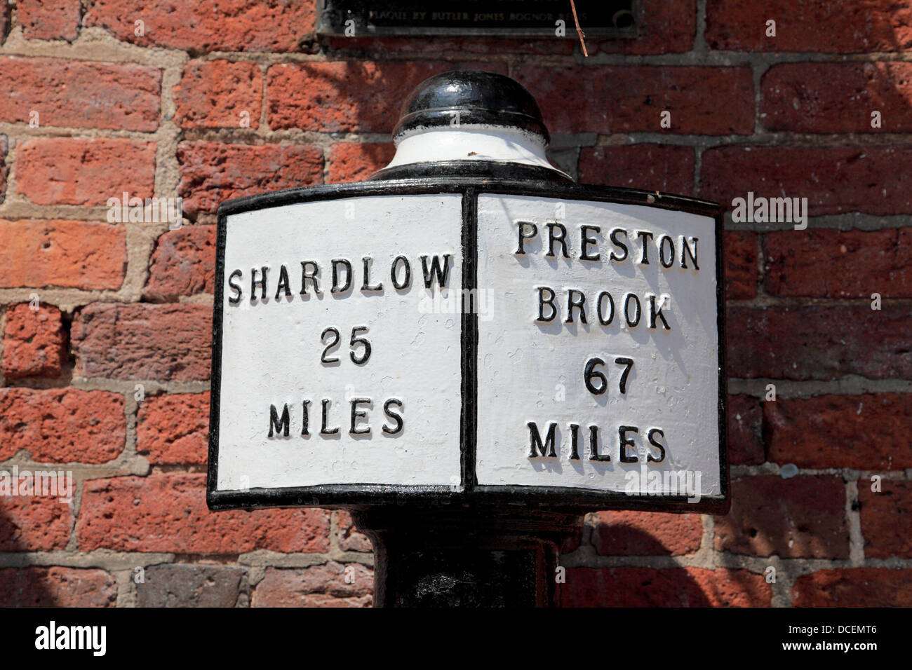 Mile post sign at Fradley Junction, Staffordshire where the Trent and Mersey Canal meets the Coventry Canal - Stock Image