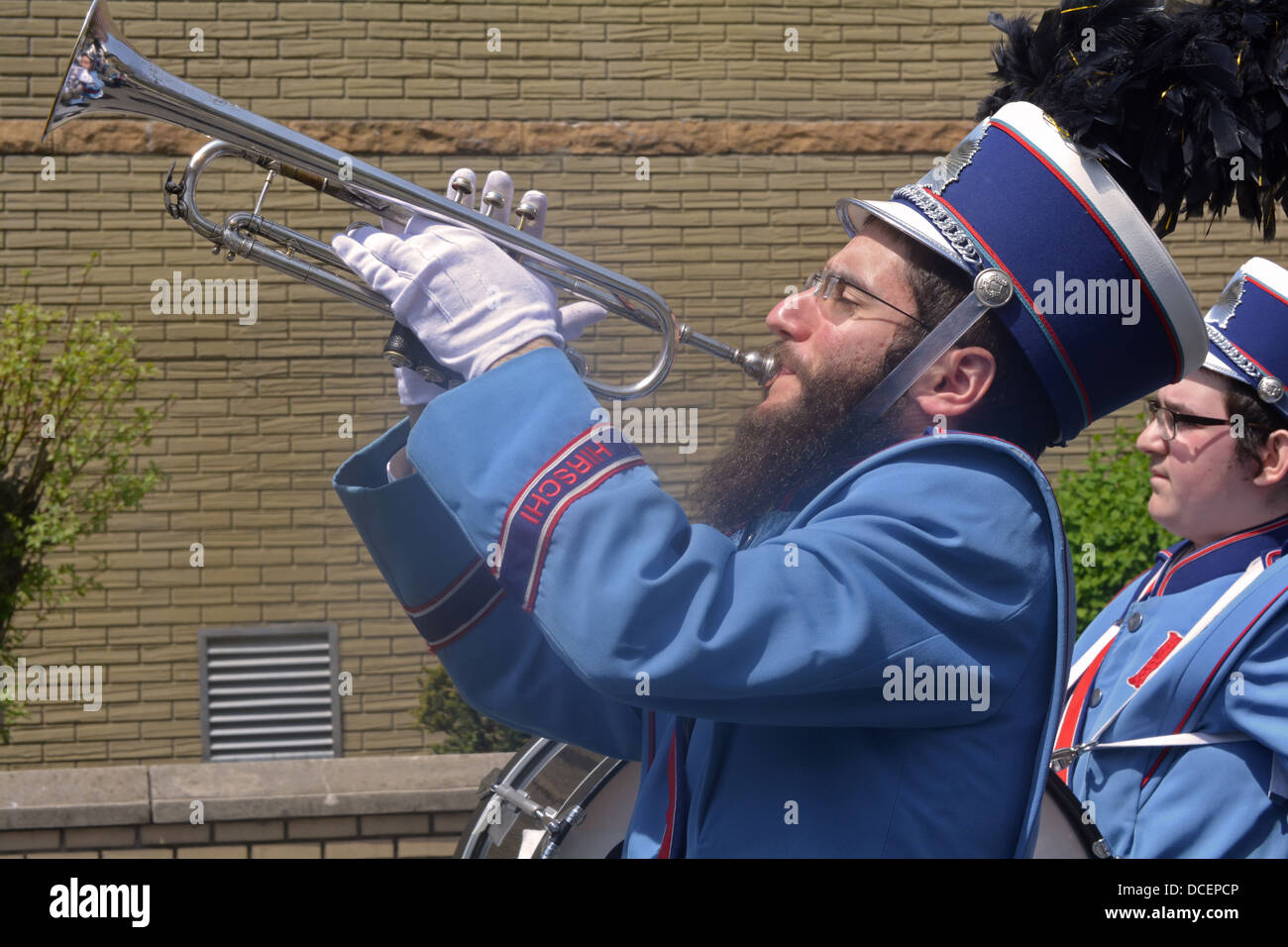 Religious Jewish man playing the trumpet and marching in the Lag B'Omer parade in Crown Heights, Brooklyn, New - Stock Image