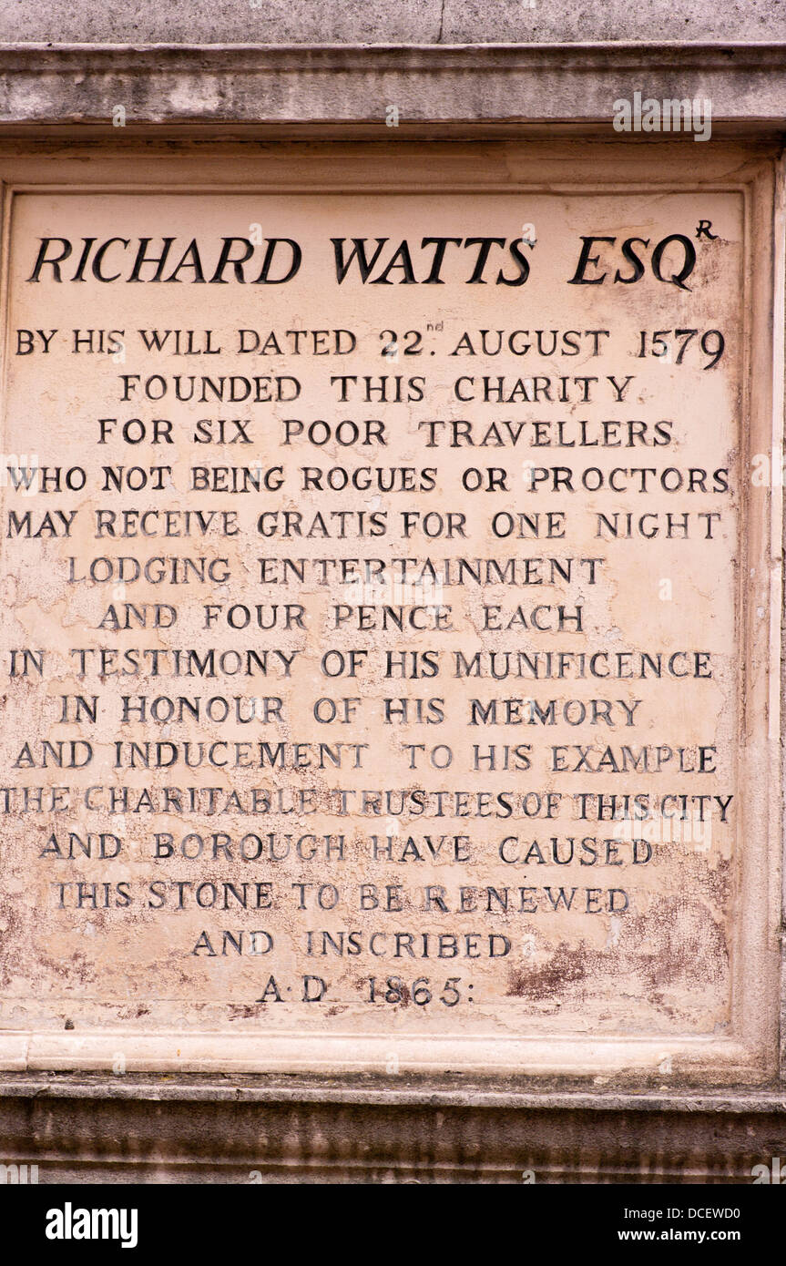 Stone Plaque in Rochester High Street Kent UK dedicated to Richard Watts who founded The Charity for Six Poor Travellers - Stock Image