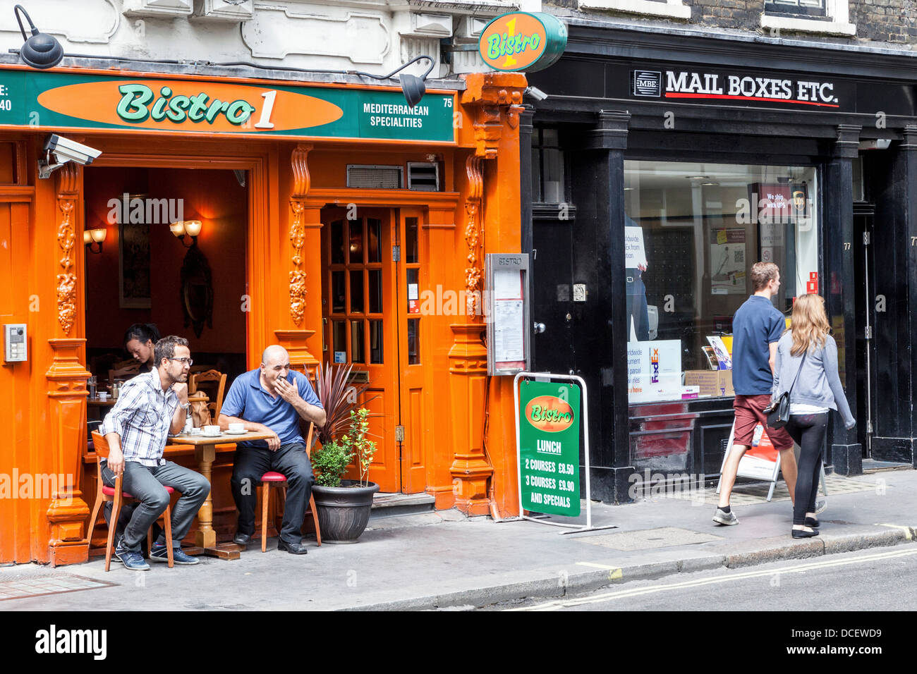 'Bistro1' serving Mediterranean specialities and 'Mailboxes etc' in Beak street, London - Stock Image
