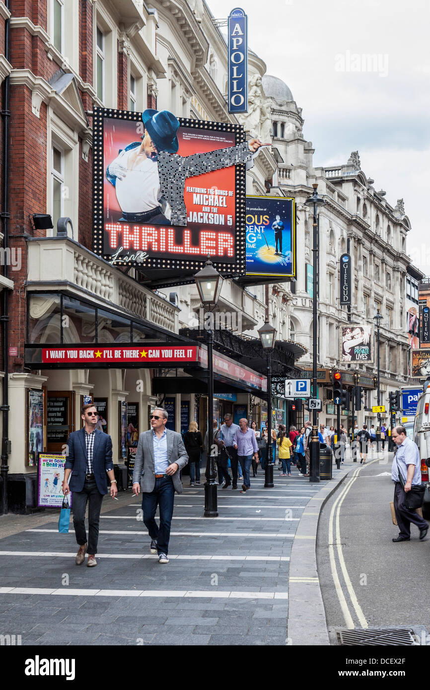 People walking past Lyric and ApolloTheatres - Shaftesbury Avenue, West End, London, W1, - Stock Image