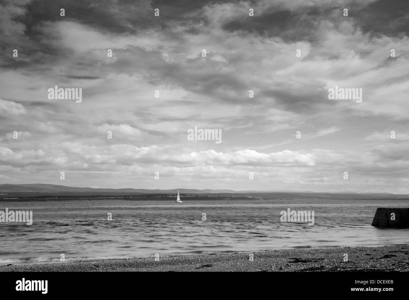 Sail boat under big sky - Stock Image