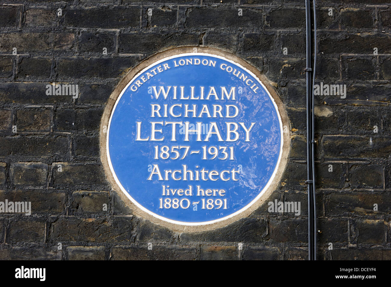 glc blue plaque on a building for william richard lethaby London England UK - Stock Image