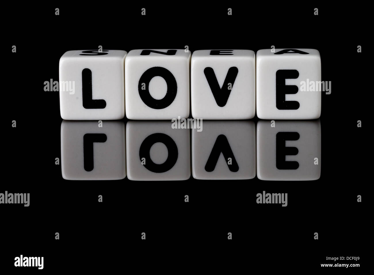 Love Spelled In Dice With The Word Reflected On White Isolated Background