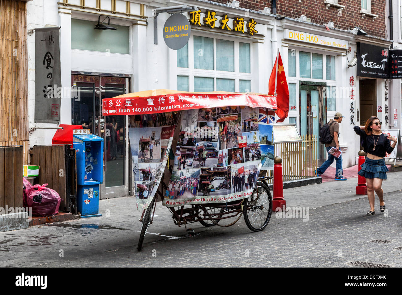Tricycle of cycling Chinese traveller parked in Gerrard Street ChinaTown, London W1 - Stock Image